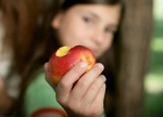 Child eating peach